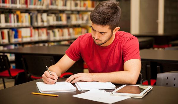 Student in the library developing good study habits